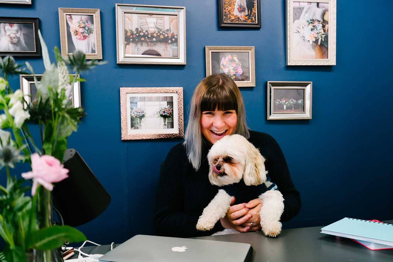 Successful Business Betty Bluebell - Emma and her dog Ted at her work space at Storage Vault